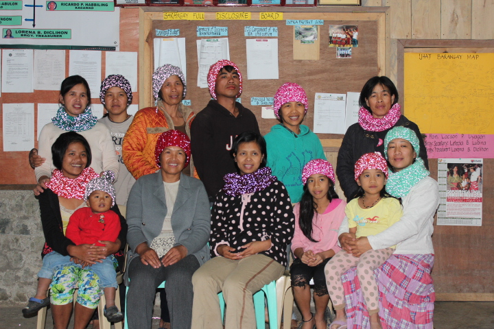 Women in Ifugao, Philippines, wearing reflective knitwear by On the Glo