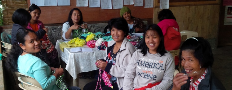 Women in the Philippines, knitting with reflective yarn for On the Glo