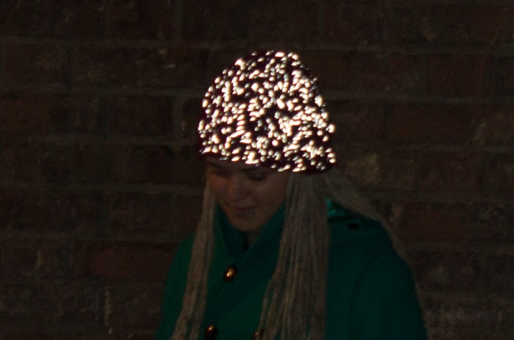 On The Glo beanie glowing strong in the dark